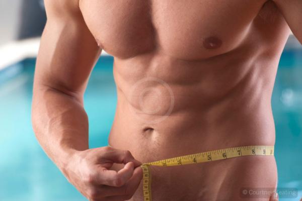 Man measuring his waist line
