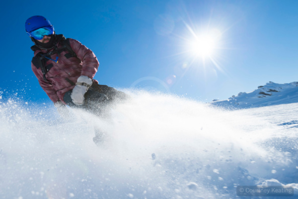 Snowboarder turning action