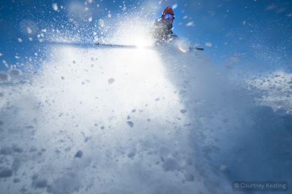 Skier turning in a spray of snow