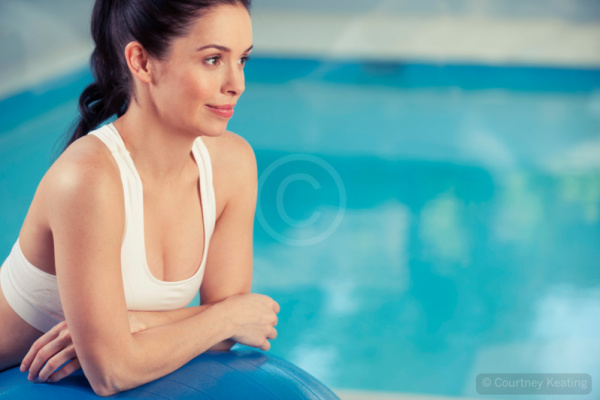 Woman resting on an exercise ball